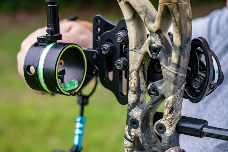 Colorado hunter focusing on the bow sight on his compound bow
