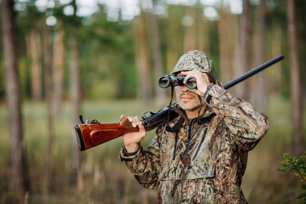 a hunter with Soap Mesa Outfitters using binoculars to hunt