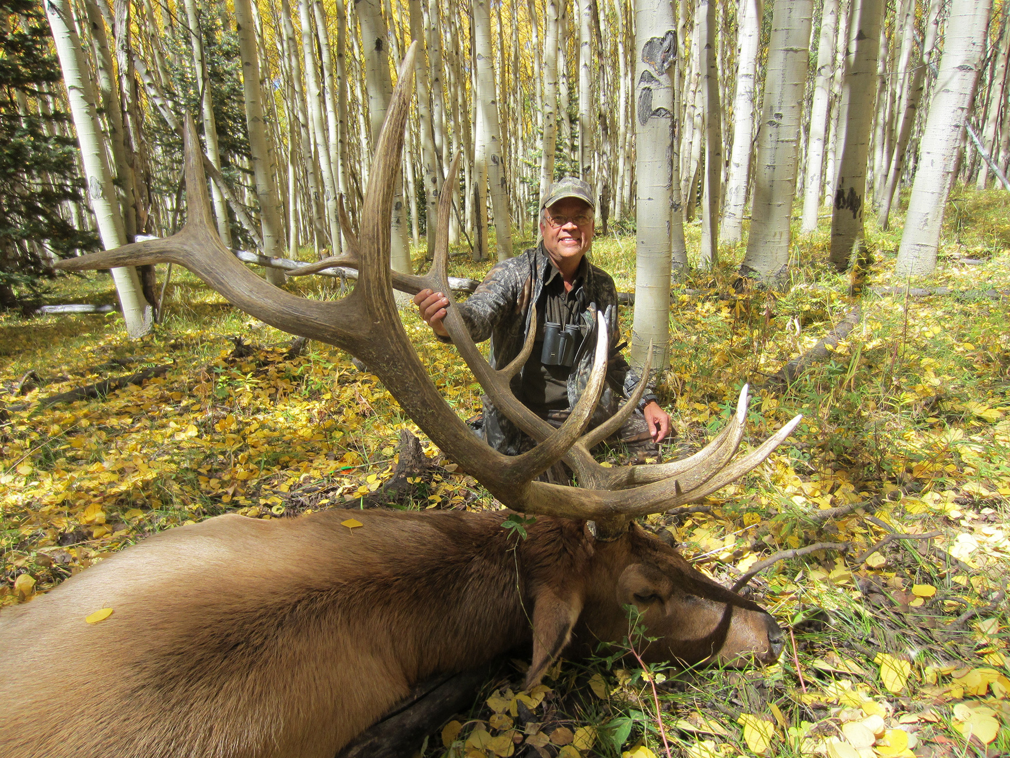 Hunter with his elk prize